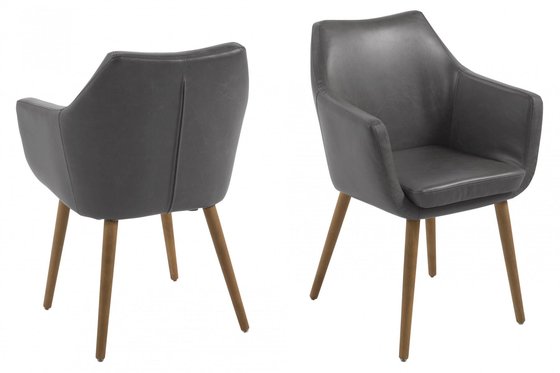 Nete er en gr polstret spisebordsstol med armln