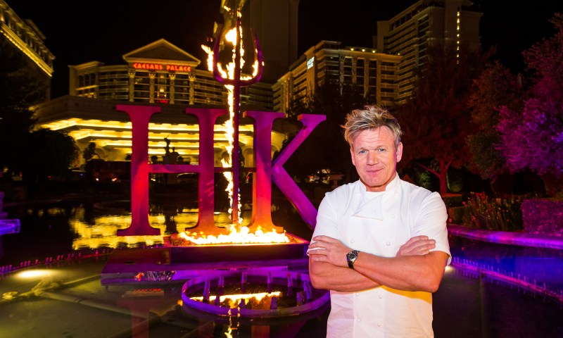 Chef Gordon Ramsay poses with series signature pitchfork in front of the iconic fountains at Caesars Palace Las Vegas announcing the upcoming winter debut of Gordon Ramsay Hells Kitchen restaurant.