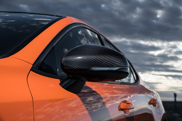 """Stinger GTS' sport-inspired styling elements including genuine carbon fiber parts and exclusive """"Federation"""" bright orange paint color command even more attention."""