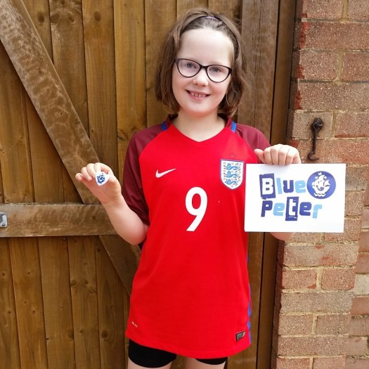 H earns her first Blue Peter badge