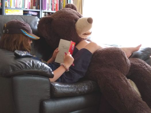 H and Hagrid the bear chilling on the settee