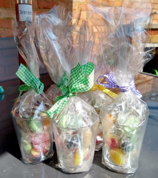 end of term gifts - glass cut glasses filled with sweets