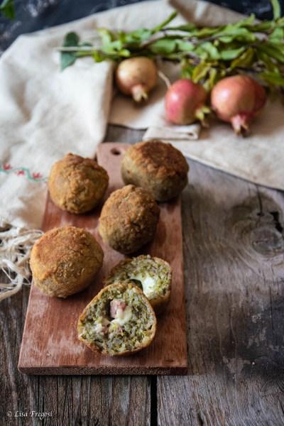 arancine al pesto di pistacchi con mortadella e provola