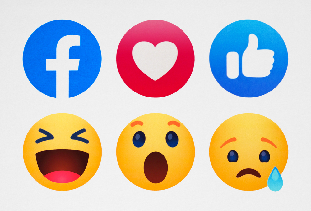 A group of emojis, showing a variety of faces and social media symbols