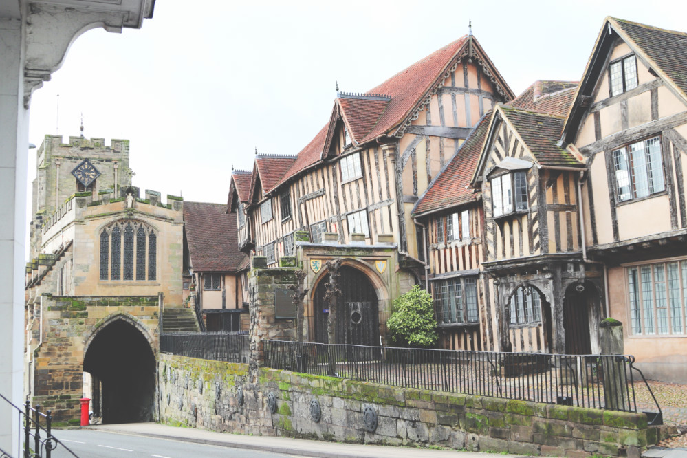An exterior photograph showing the buildings at Lord Leycester Hospital in Warwick, the buildings are old so are leaning in different directions