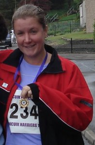 with a medal at the end of a running race