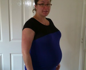 Me at about eight months pregnant