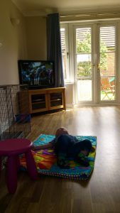 baby napping while the tour de france is on the tv