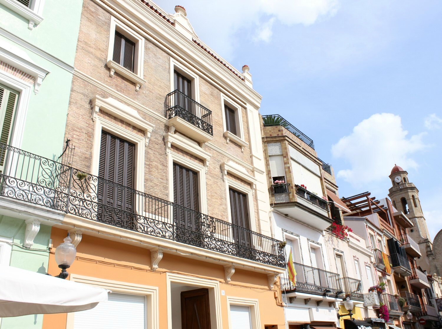 The picturesque buildings with their pastel colours and metal balconies in Calella.My photo tour of Costa Barcelona