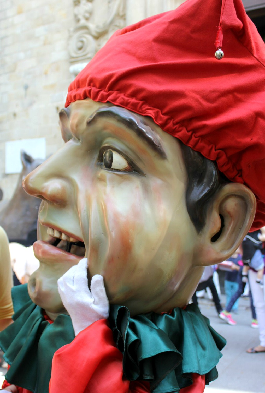 One of the traditional characters at Calella's Festa Major, a large headed jester. My photo tour of Costa Barcelona