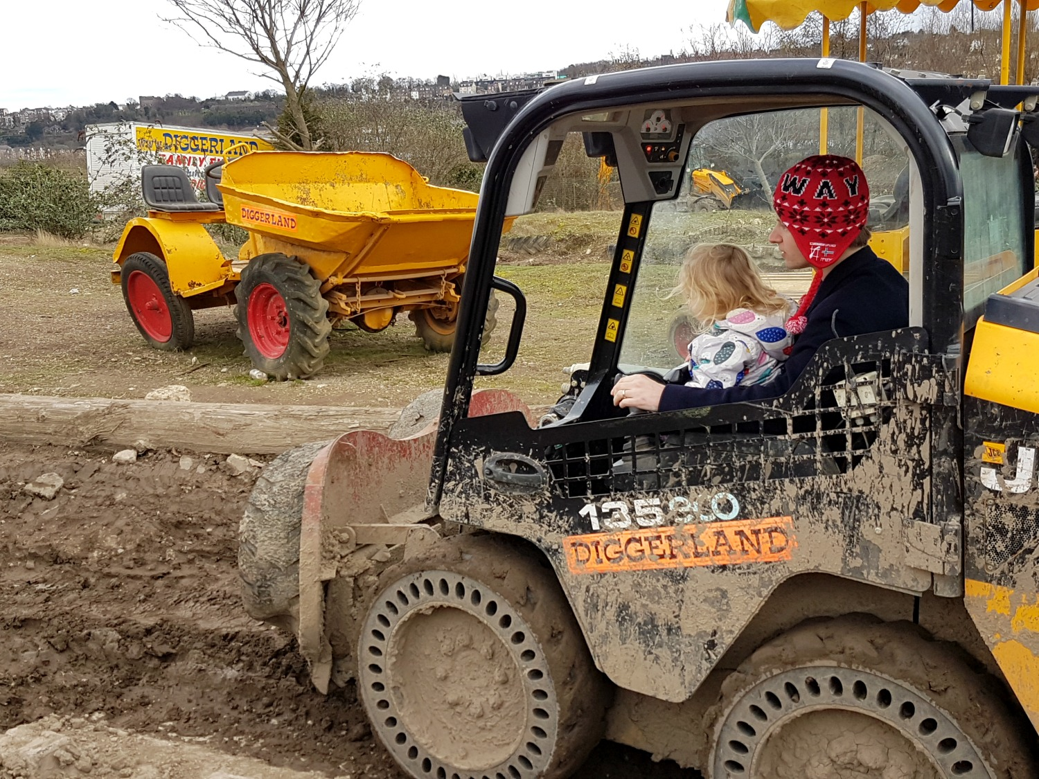 My daughter getting behind the wheel at Diggerland Kent - one of the attractions on this family day out