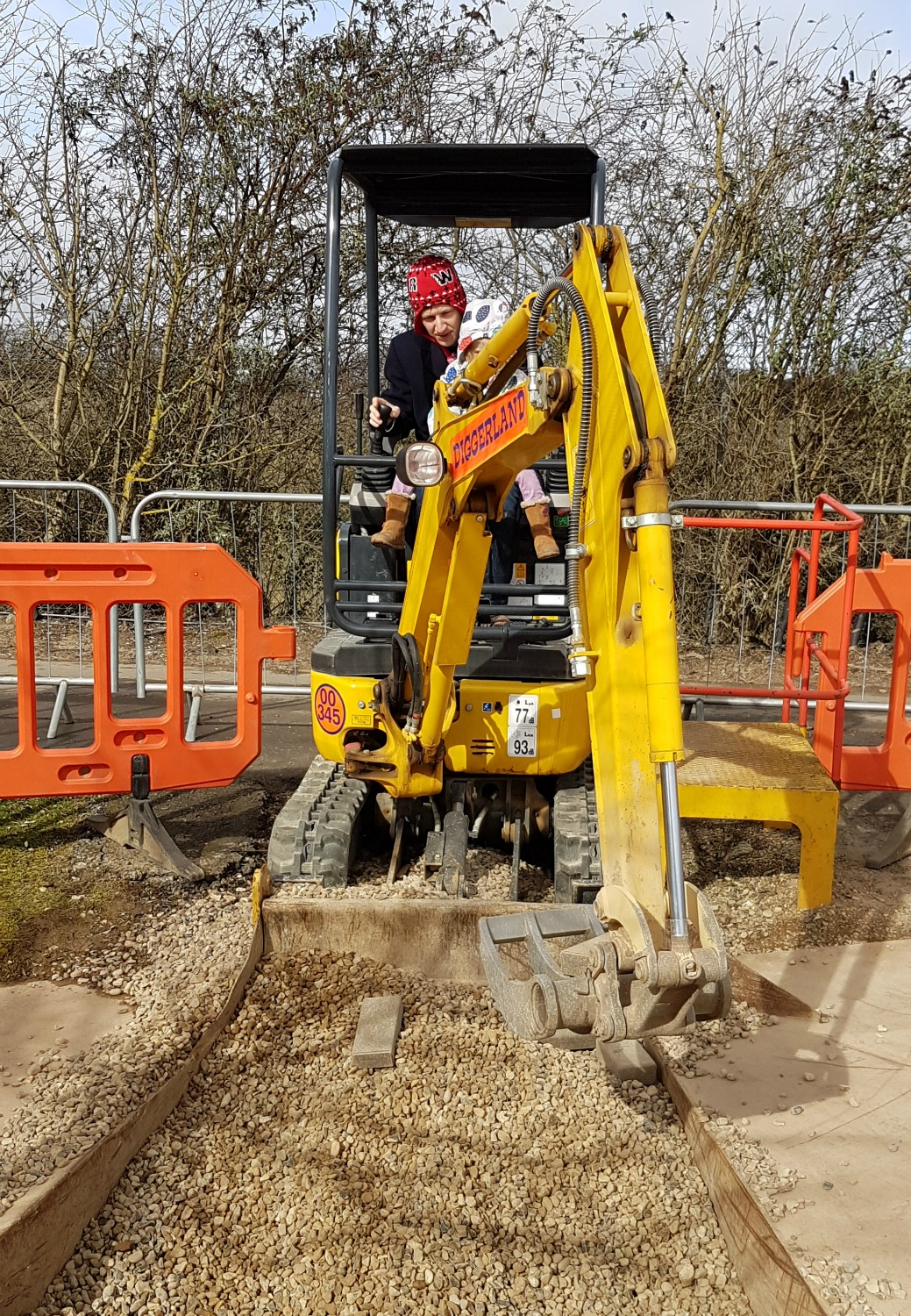 Hunting for bricks with a digger at Diggerland Kent - one of the attractions on this family day out