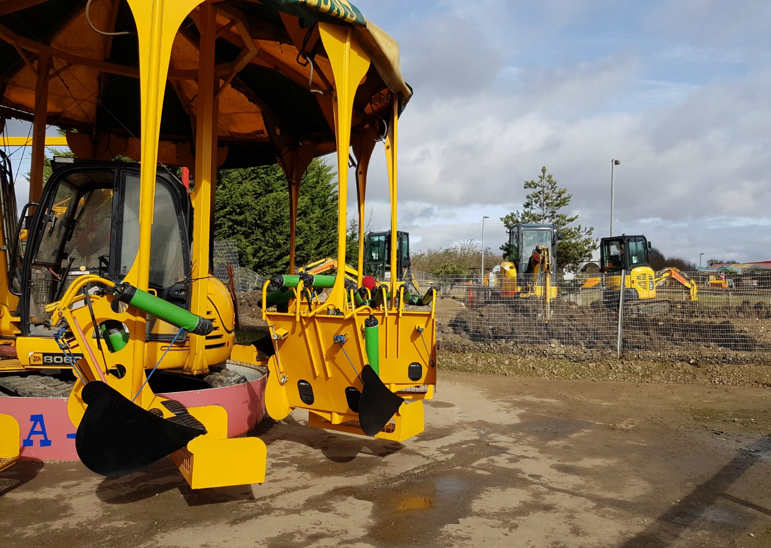 The digger-style carousel at Diggerland Kent - one of the attractions on this family day out
