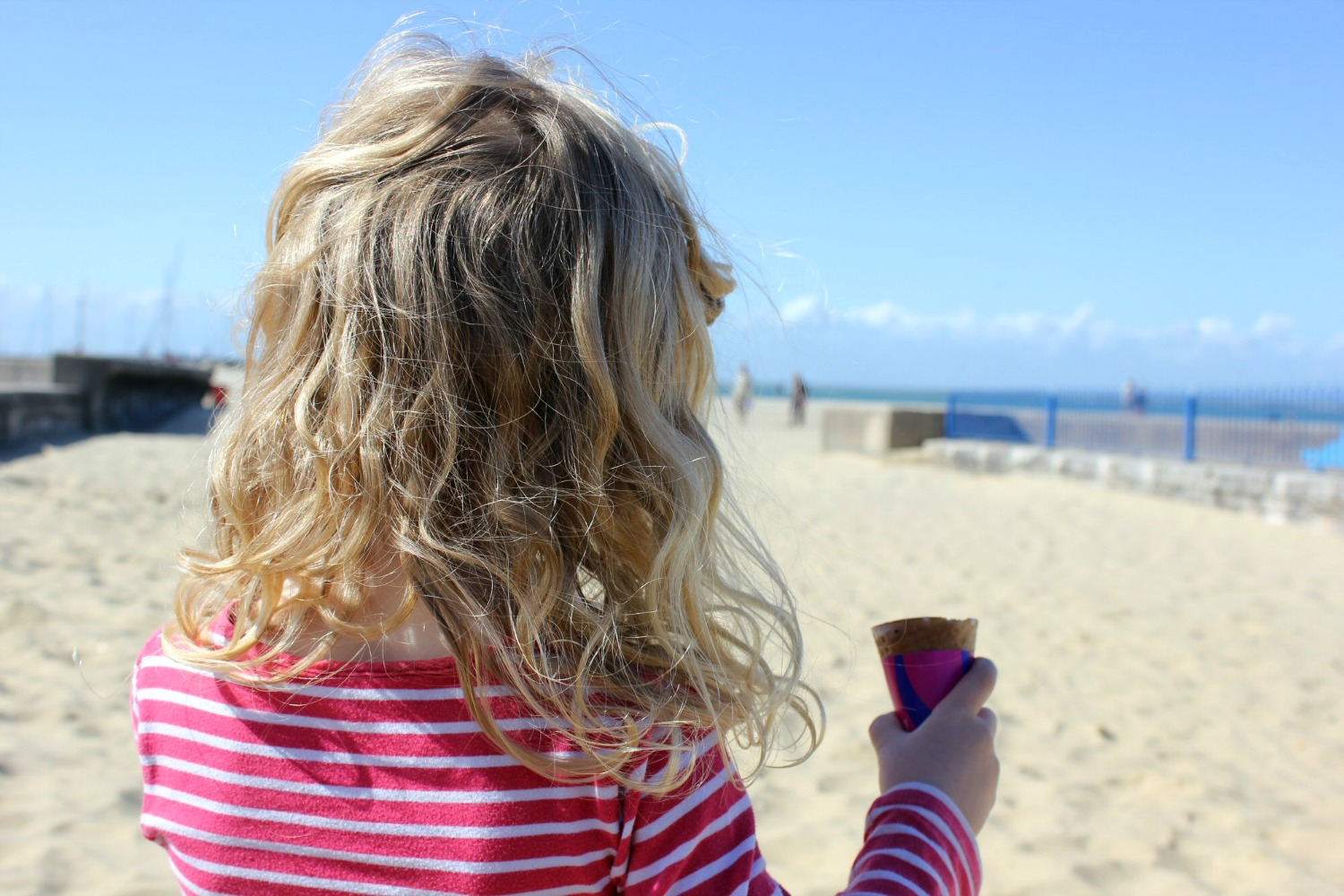 My daughter with her ice cream cone on the beach - discovering the Isle of Wight coast