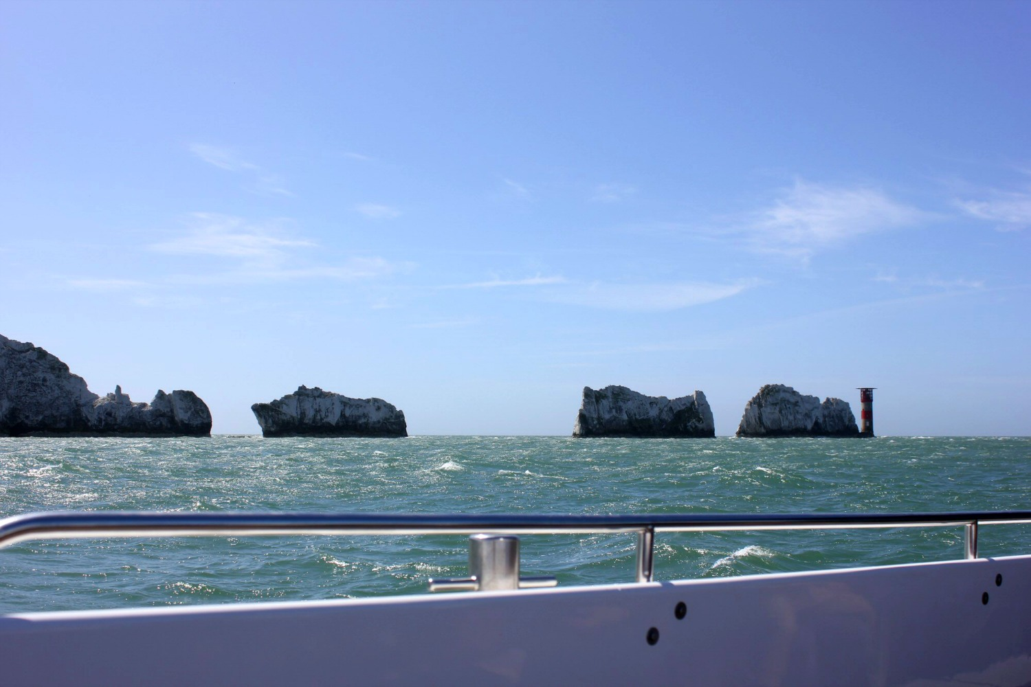 A view onto the turquoise sea, looking out to The Needles from our boat - discovering the Isle of Wight coast