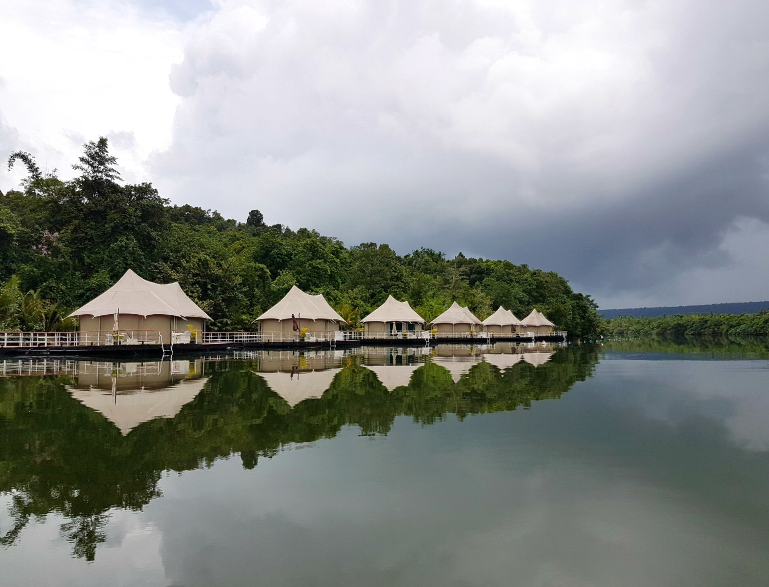 A row of tents at Four Rivers Floating Lodge in the Cardamom Mountains - 12 reasons to visit Cambodia with kids