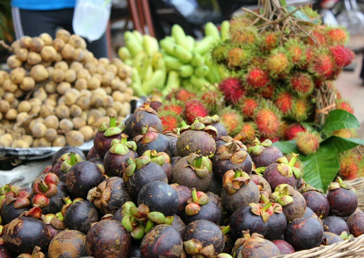 Piles of fruit for sale in Siem Reap - 12 reasons to visit Cambodia with kids