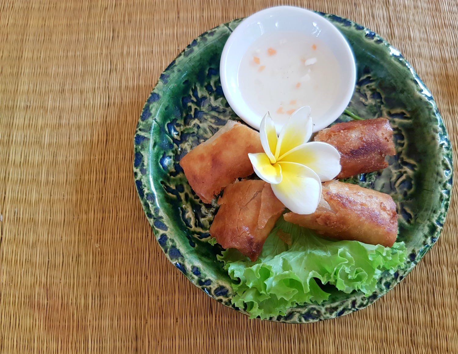 Spring rolls with a frangipani flower - my top 13 tips for Cambodia with kids, the lessons learned from our family travel in the country