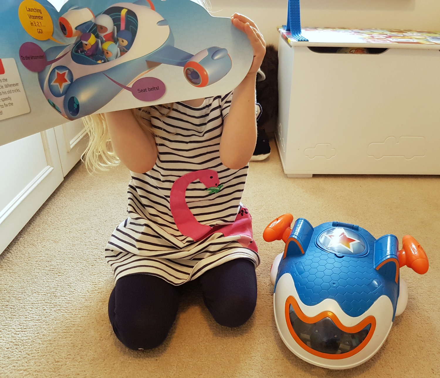 My daughter holds up the new Go Jetters: Jet Set Go Board book along with her toy Jet Pad - my Go Jetters Jet Set Go review and giveaway