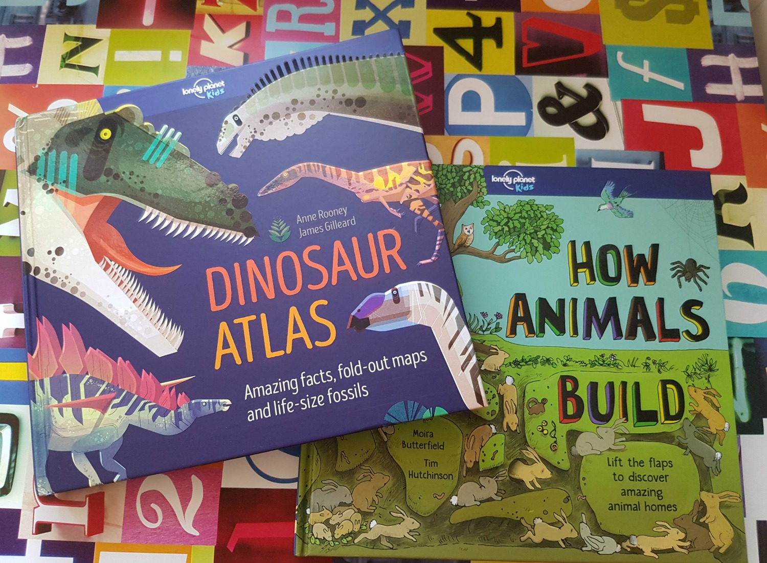 Cover of the Lonely Planet Kids book Dinosaur Atlas and How Animals Build - one of my November travel essentials