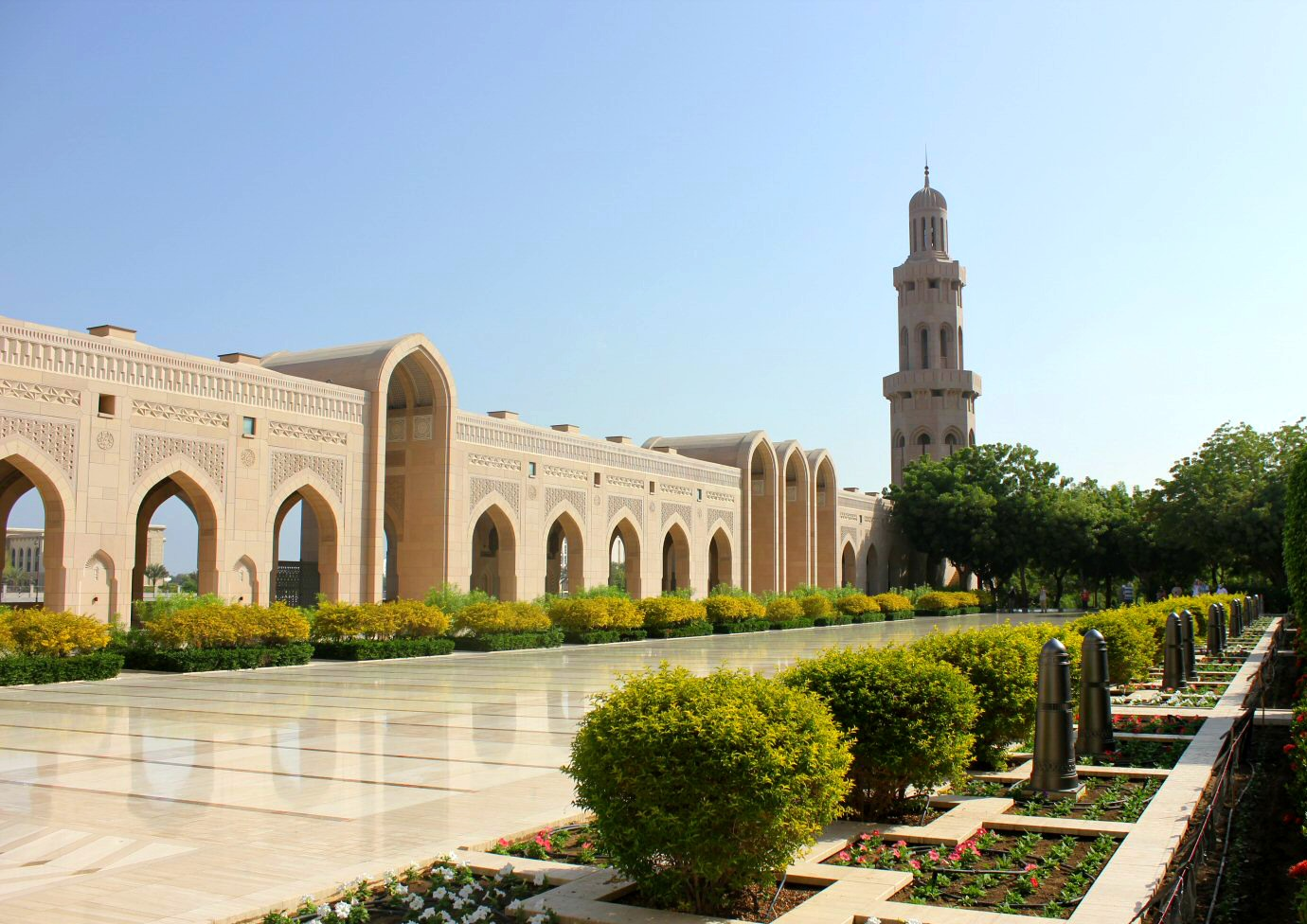 A view of the gardens and part of the Sultan Qaboos Grand Mosque in Muscat Oman - the beautiful architecture is one of my nine reasons to visit Oman with kids