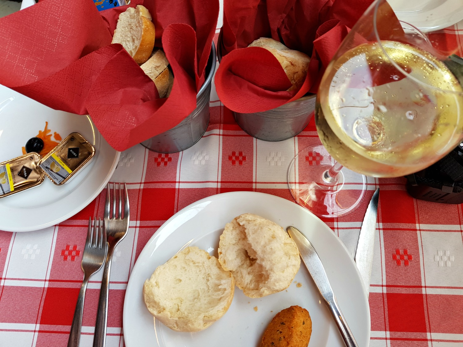 Starting a long lunch in Porto with bread and other snacks as part of the covert - my Porto travel tips and lessons for visiting the city with kids
