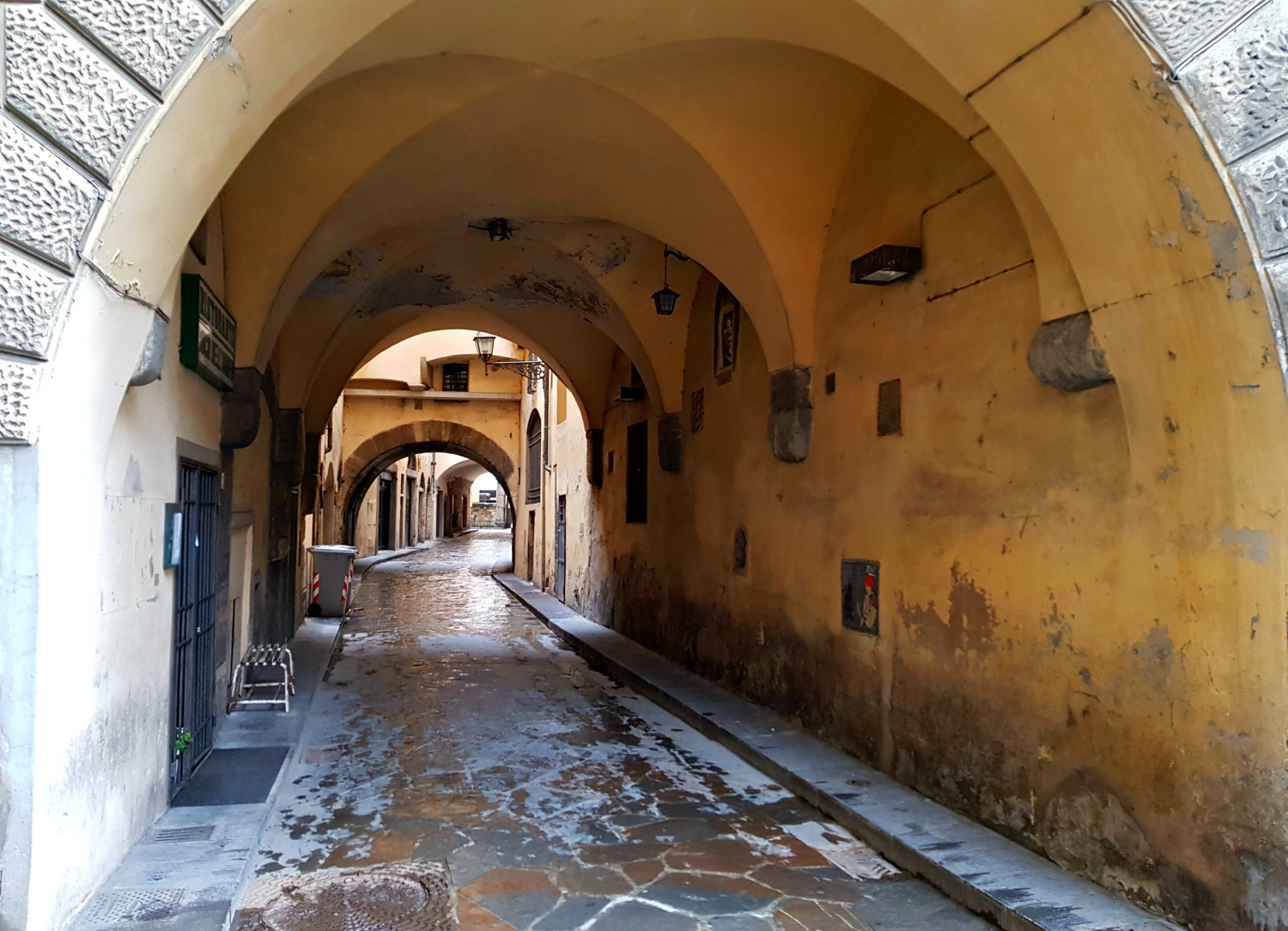Alleyway leading through a tunnel in Florence, Italy - my Uffizi tour with kids and gelato making day in Florence