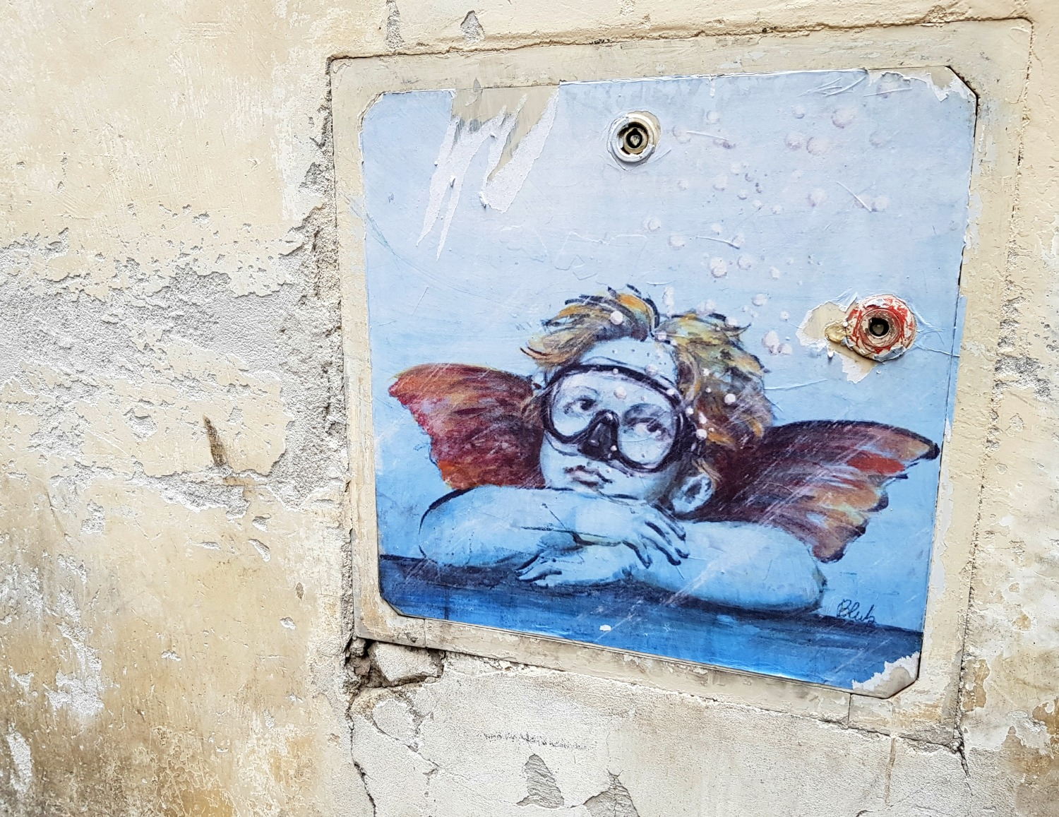 Updated cherub street art in Florence, Italy - my Uffizi tour with kids and gelato making day in Florence