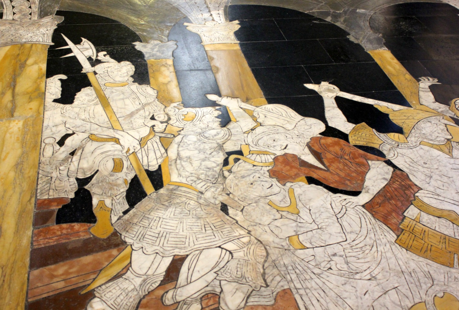 Bible stories marked out in marble on the floor of the cathedral - exploring Siena with kids, our tour discovering art, history and animals