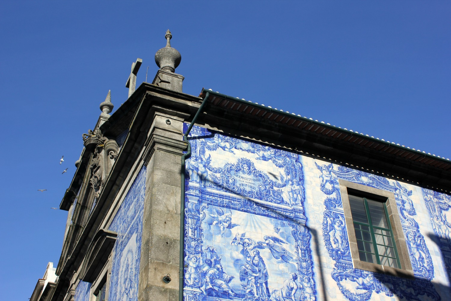 Tiled exterior of an old convent against a blue sky in Porto - my Porto travel tips and lessons for visiting with kids