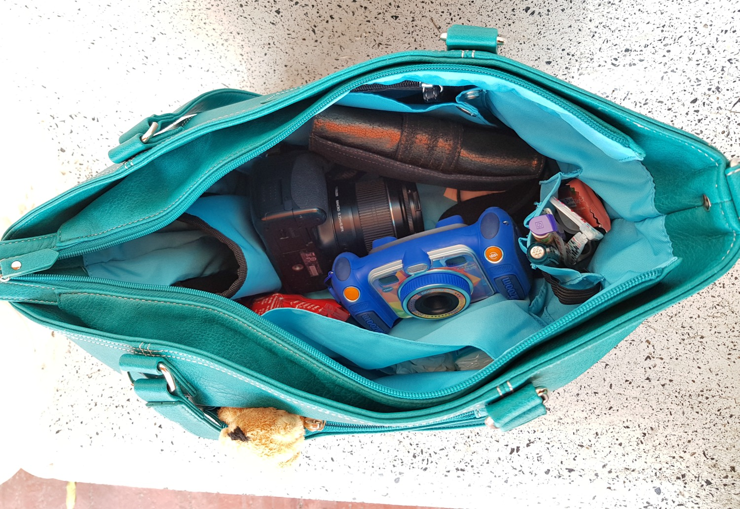 Looking inside the Mini Jen bag on a day out in Langkawi, including two cameras, purse and other travel essentials - my Mia Tui hand luggage review
