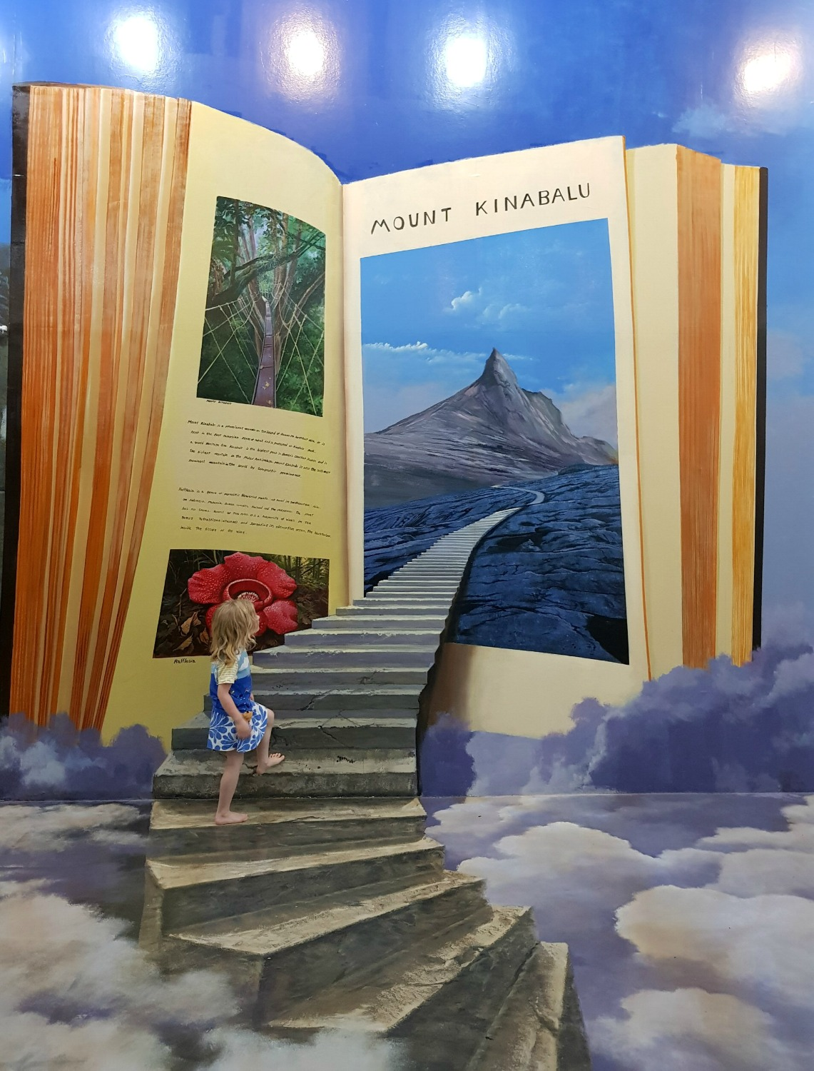 My daughter walking into a book at Langkawi Art in Paradise, one of Malaysia's 3D art museums
