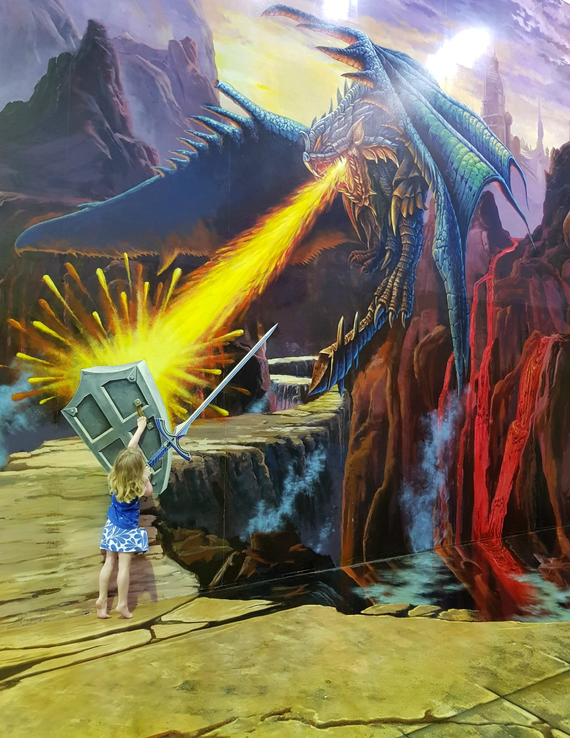 My daughter battling dragon fire at Langkawi Art in Paradise, one of Malaysia's 3D art museums