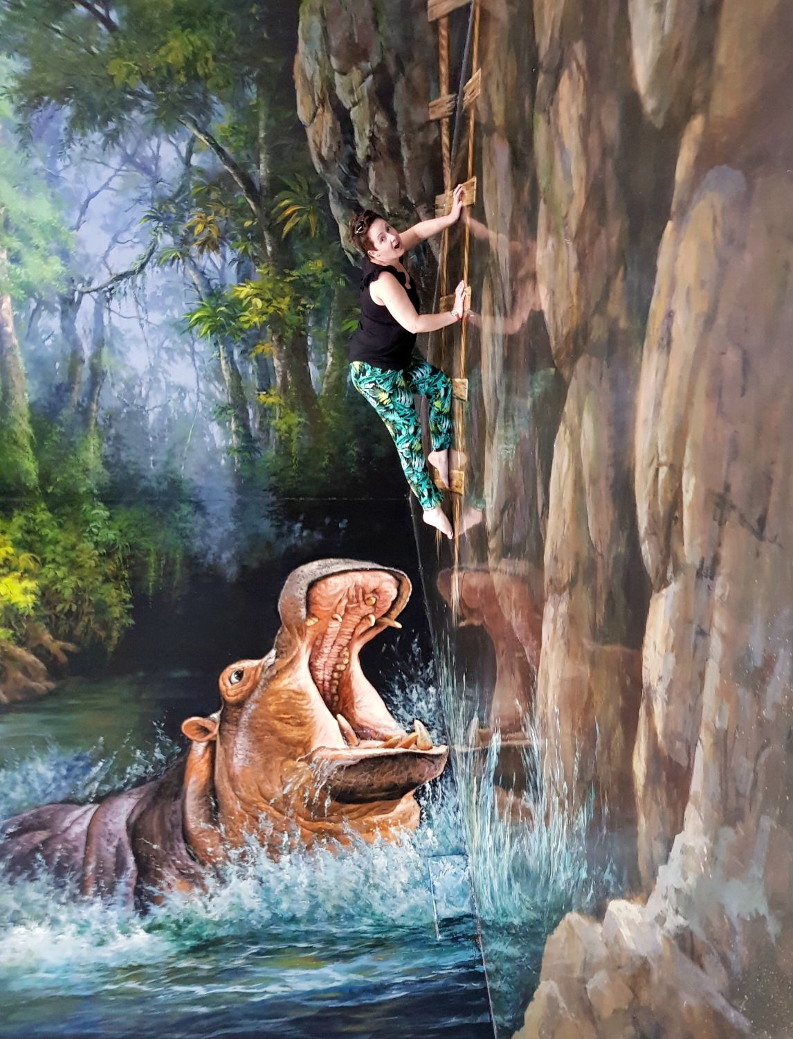 Me escaping a hippo at Langkawi Art in Paradise, one of Malaysia's 3D art museums