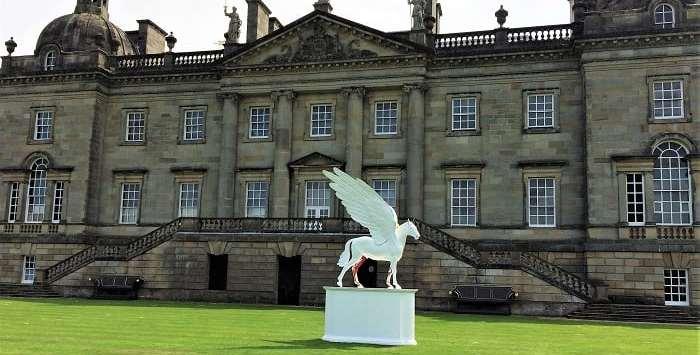 Houghton Hall exterior wiht Damien Hirst's Legend