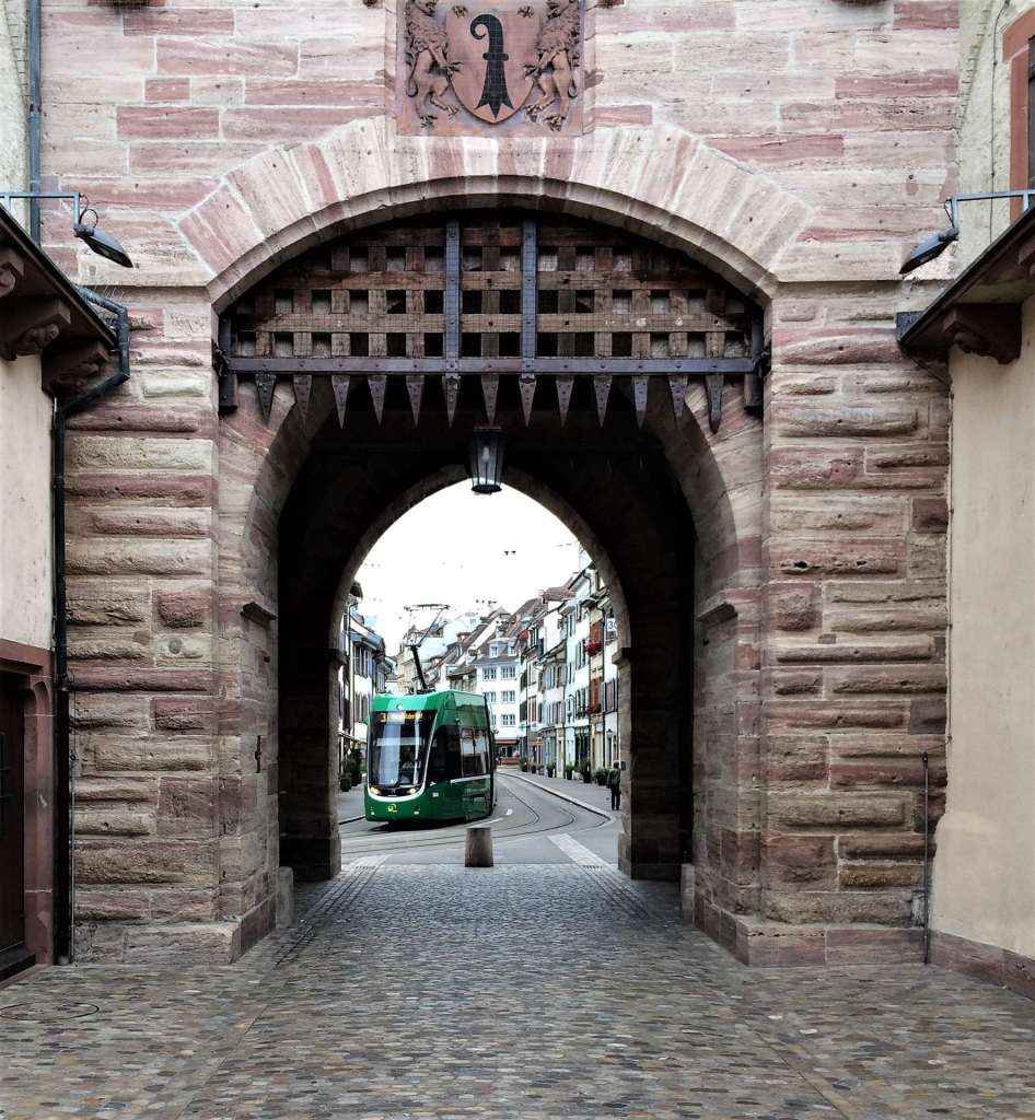 Spalentor city gate in Basel with tram in distance