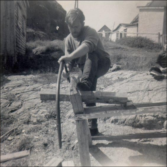Gerry Squires sawing wood