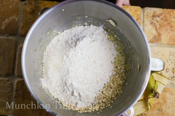 Add flour mixture and oats and mix until combined.