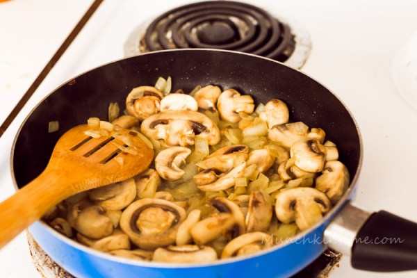 In the skillet with olive oil saute onion on a medium heat until translucent color.  Add sliced mushrooms and saute it for about 3-5 minutes.
