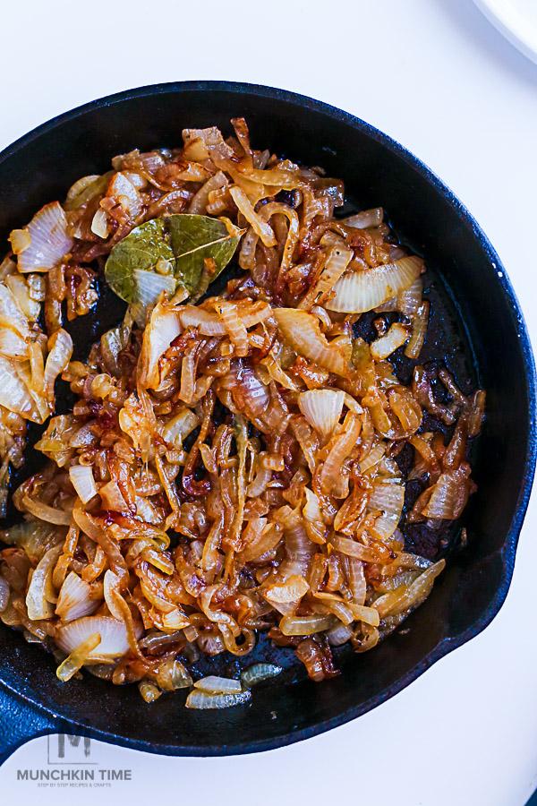 Caramelized Onion Arugula Burger Recipe - The Juicy Cheesy Burger! -- #burgerrecipe #homemadeburgers