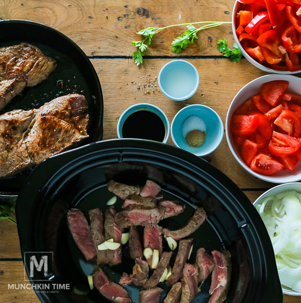 Tender Crock Pot Pepper Steak in amazing thick sauce. Easy dinner recipe for busy moms.