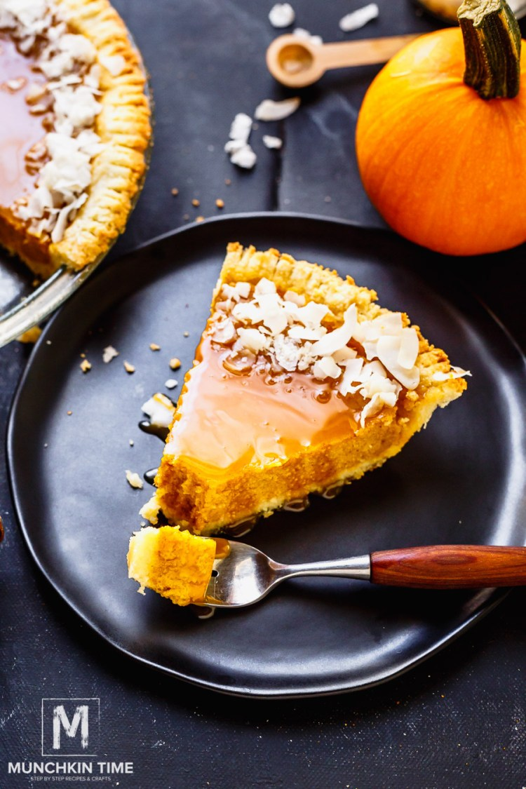 !How to make Pumpkin Pie: Preheat the oven to 350F. Using food processor or a blender. Combine 2 1/2 cups of fresh pumpkin puree, 1 egg, 1/8 of salt, 1/2 teaspoon ginger, 1 teaspoon ground cinnamon, 1/2 teaspoon nutmeg, 1/8 teaspoon ground cloves, and 1 can of condensed milk. Pulse until everything is combined, then pour the pumpkin filling into a prepared gluten free pumpkin crust. Bake for 55 - 60 minutes, or until knife inserted in the center comes out clean. Let the pumpkin pie cool. Drizzle the caramel over the top and garnish with coconut flakes. Cut a slice and enjoy!