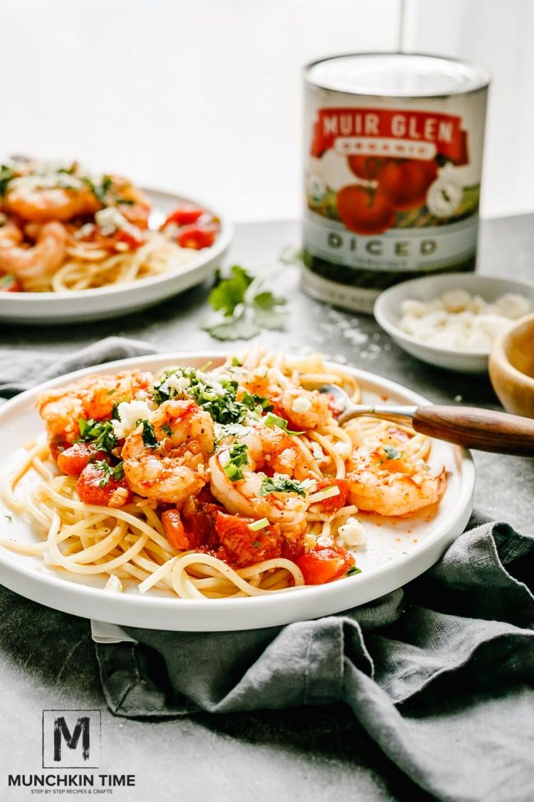 Super Delicious Italian Shrimp Tomato Pasta Recipe with feta cheese and cilantro greens.