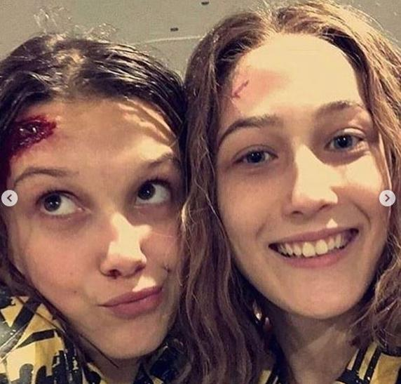 Eleven (Millie Bobbie Brown) along with her double in the series.