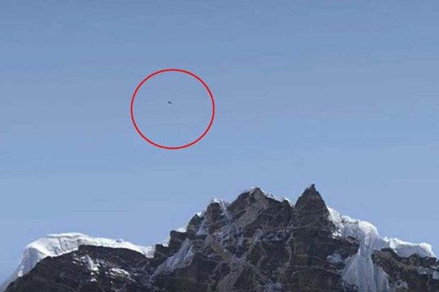 UFO on Mount Everest - Photograph of a mountain climber shows a UFO on Mount Everest