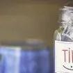 Tip jar in coffee shop or restaurant. American currency