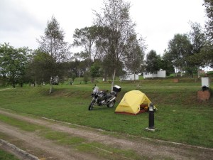 A lonely tent and bike in an otherwise deserted campsite
