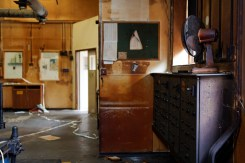 An empty workshop's stained walls are the only witness to efforts past