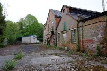 An empty loading yard outside an old mill
