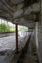 Tiled corridor leading from the changing rooms to the edge of Pripyat's broken indoor pool